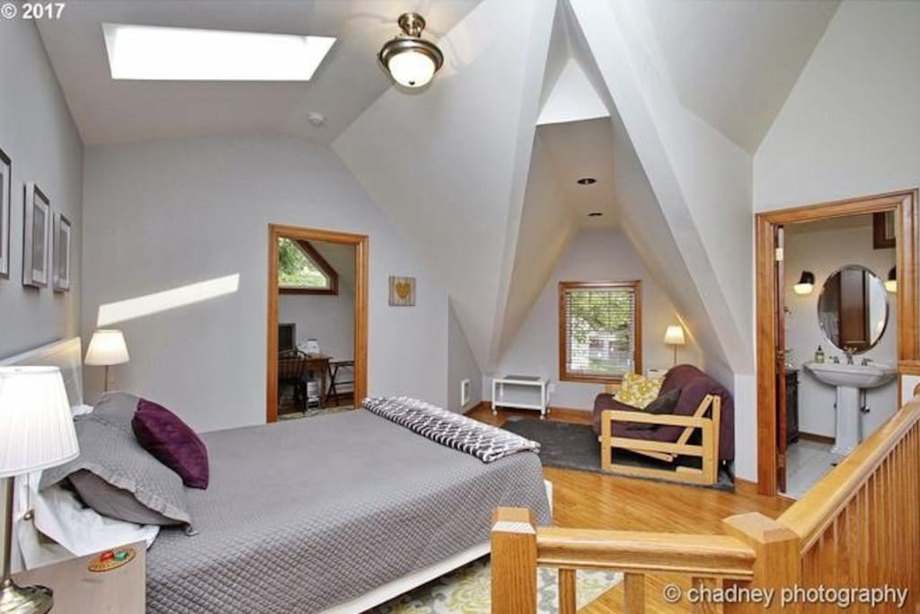 This is the main room with a comfy queen bed and skylights.