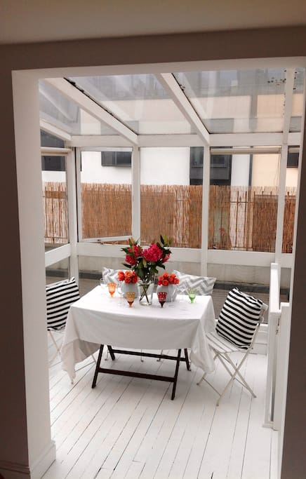 Sunny dining area with access to private terrace