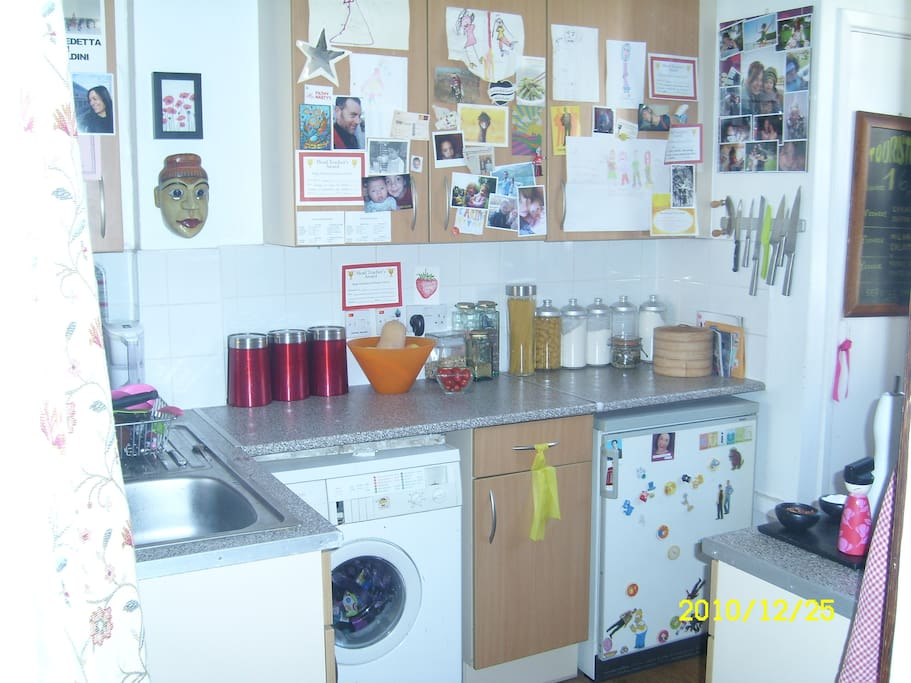 Small yet fully formed kitchen with everything you need including a huge well stocked pantry