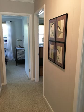 The bedrooms are at the end of the hallway.