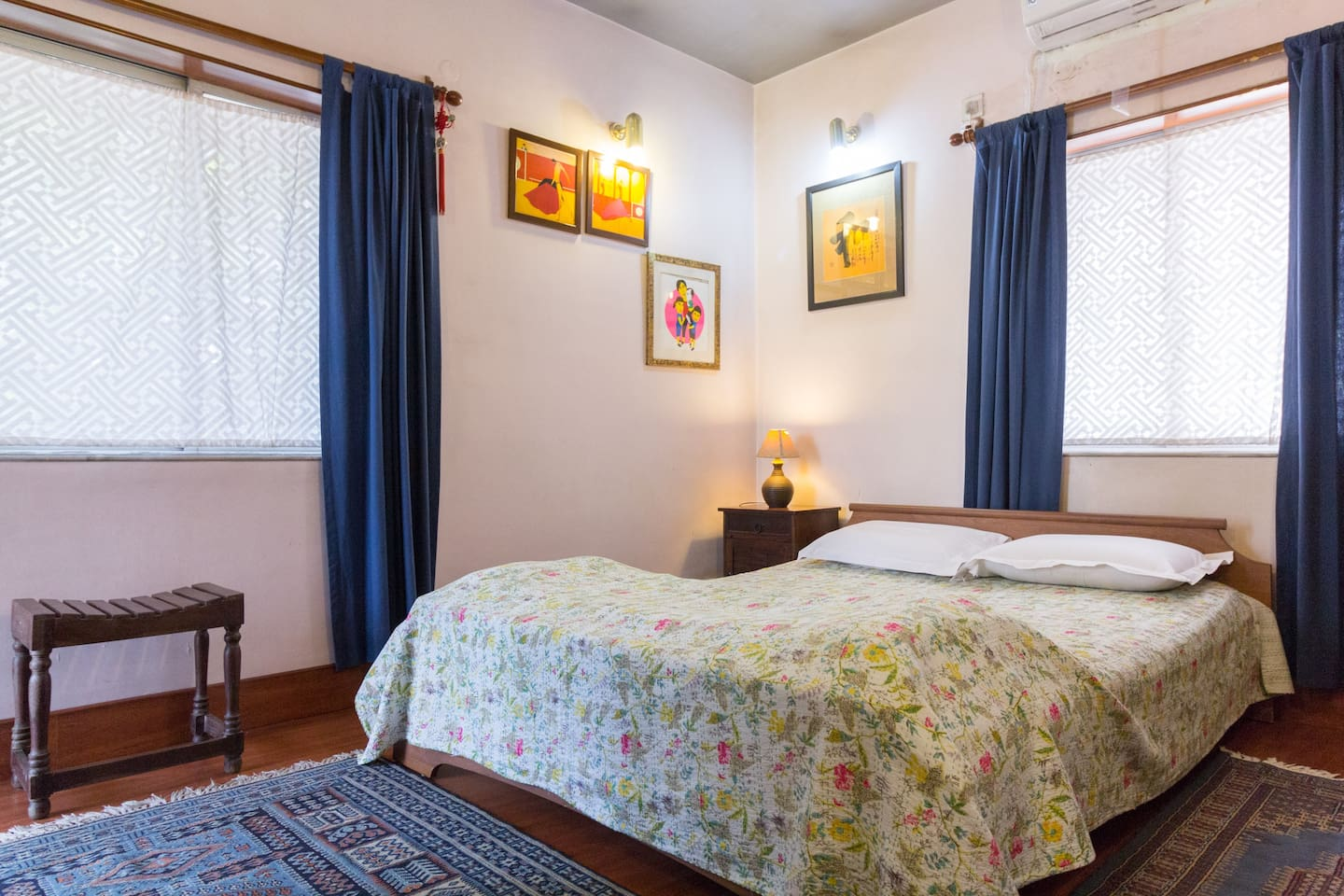 Master en-suite bedroom - wooden floors, Kashmiri handwoven carpets, 300 TC bed linen, queen sized bed, memory foam pillows, original contemporary Indian and foreign art and hand embroidered kantha eiderdowns!