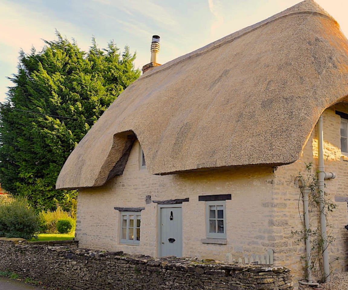 With new thatch and fresh coat of paint on the woodwork! Photo summer 2018.