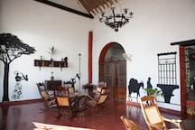 Cafè Mompox— Colonial House big  Room with fan.