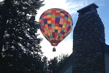 Hot air balloon going over the house