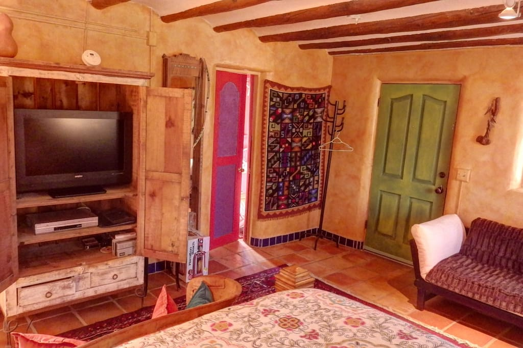 Private entrance. Bathroom entrance. TV and DVD player in antique armoire.