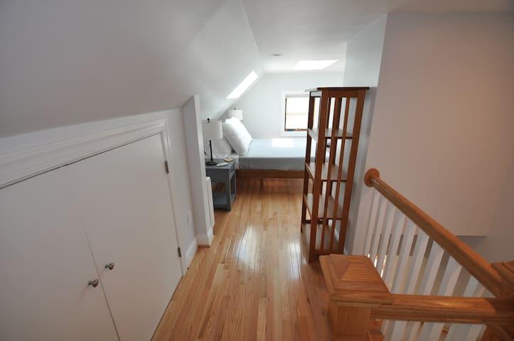 Upstairs sleeping space with plenty of storage.