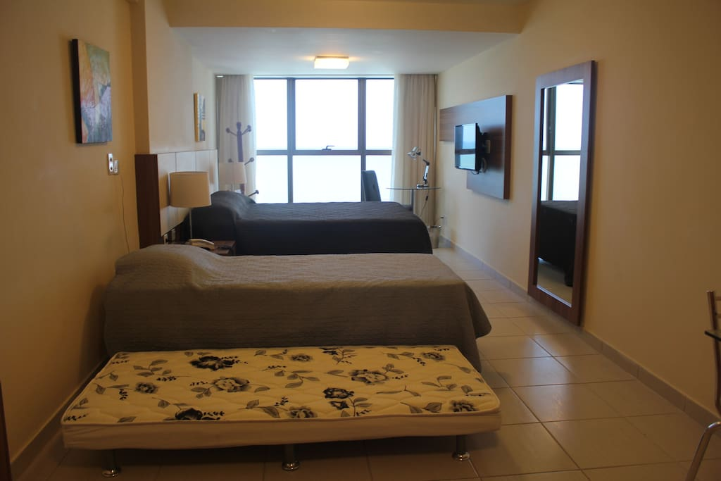 Double bed + two single beds (accommodating up to four guests)