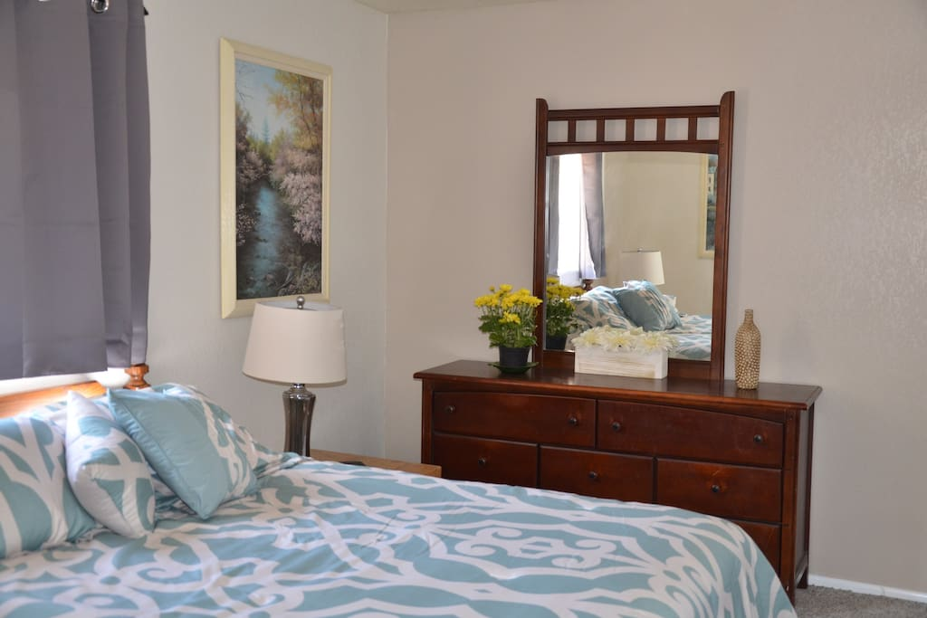 The bedroom has a queen bed and walk-in closet.