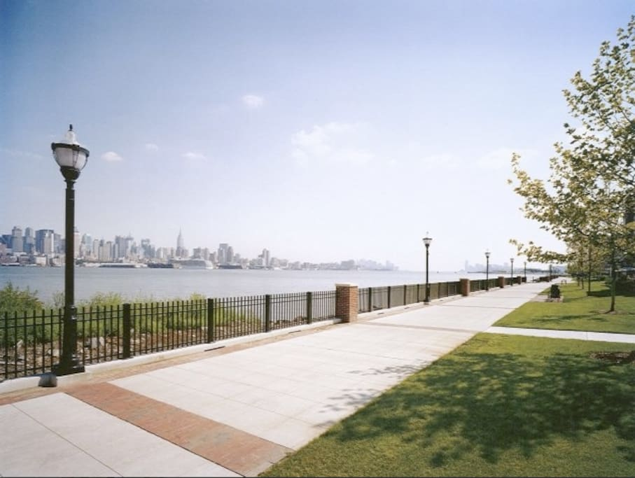 Stunning views of the NYC skyline from the Hudson River Promenade located right outside the apt.