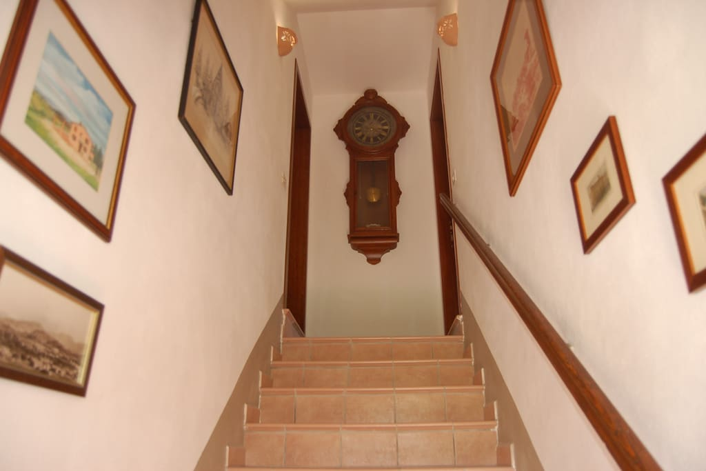 The 75 sq m (800 sq ft) apartment is located on the first floor, up these stairs to the left.