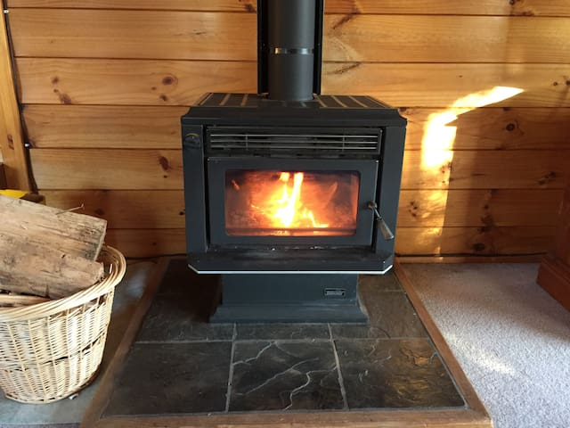 Cosy log burner (faces the lounge) - firewood is supplied. We also have fireguards under the stairwell if you have little kids (or need to dry any winter gear in front of the fire).
