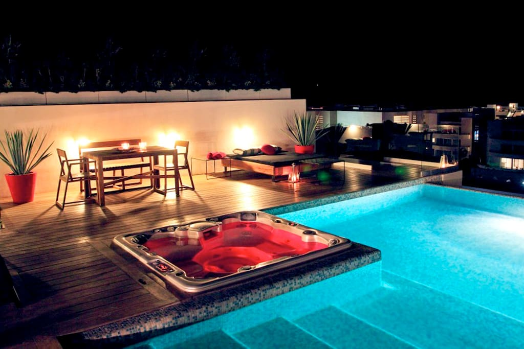 Roof top common area - The swimming pool offers sprawling Caribbean Sea views