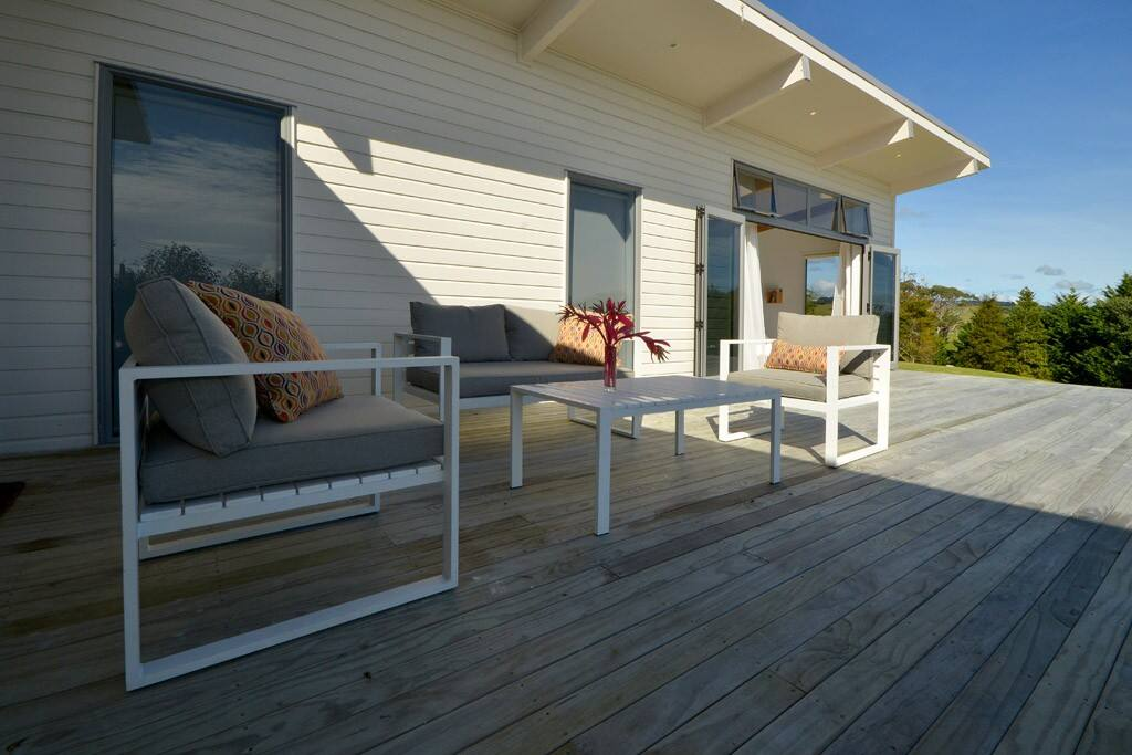 large deck with lounge seating area