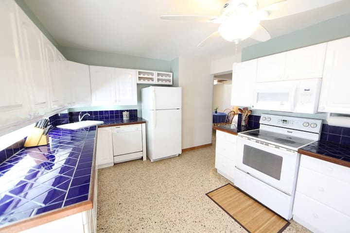 Modern kitchen with full size appliances and dishwasher