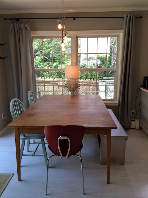 Dining table next to kitchen.