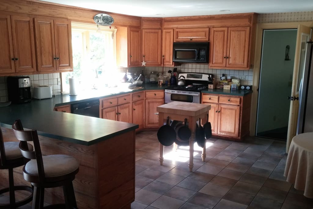 We have a beautiful large kitchen with room to cook and hang at the bar.