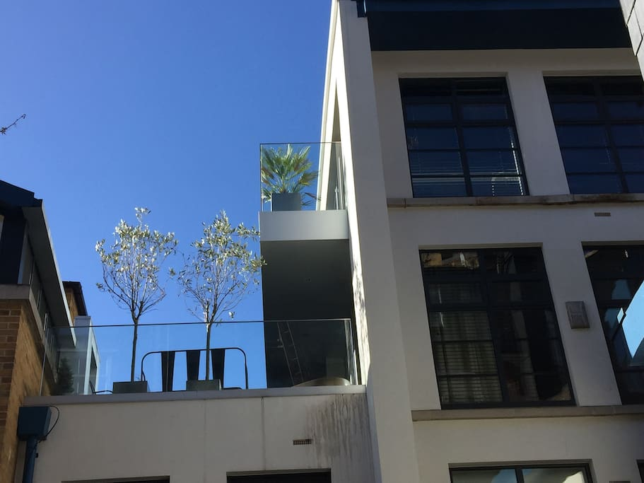 View of the penthouse terraces from the gated courtyard below