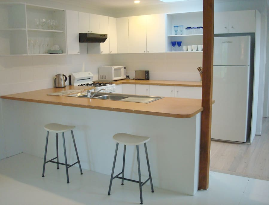 Functional well equipped U-shaped kitchen open to living and dining areas