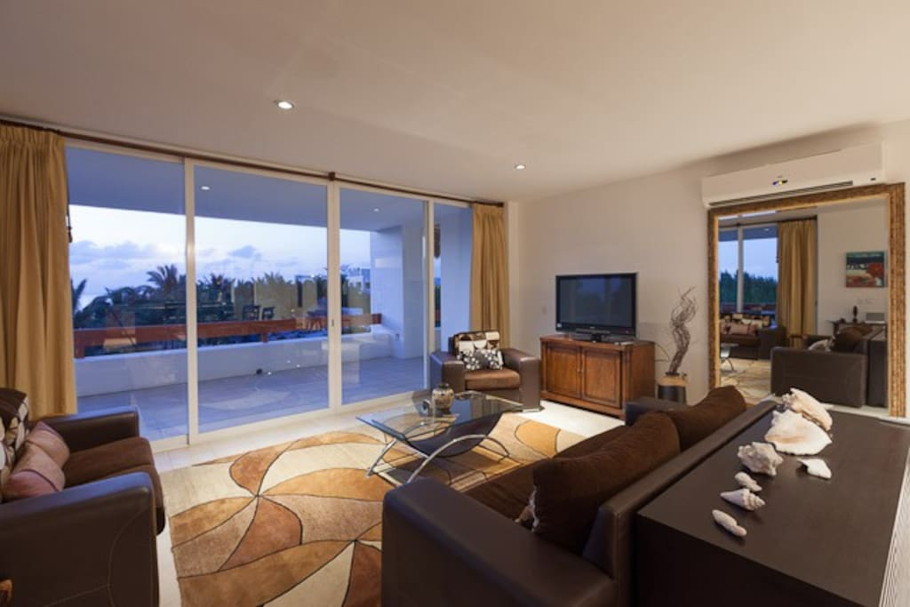 Living room with wrap-around terrace