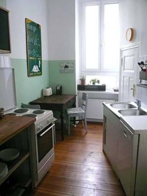 Kitchen with microwave, dishwasher, oven, washing machine and space for dining