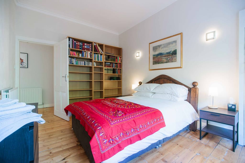 The guest double room is spacious, looks out over a green area and has a new king size bed