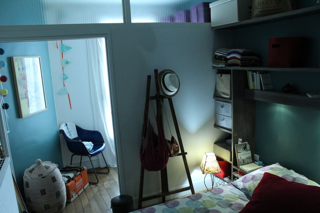 view of bedroom with access to the baby's space