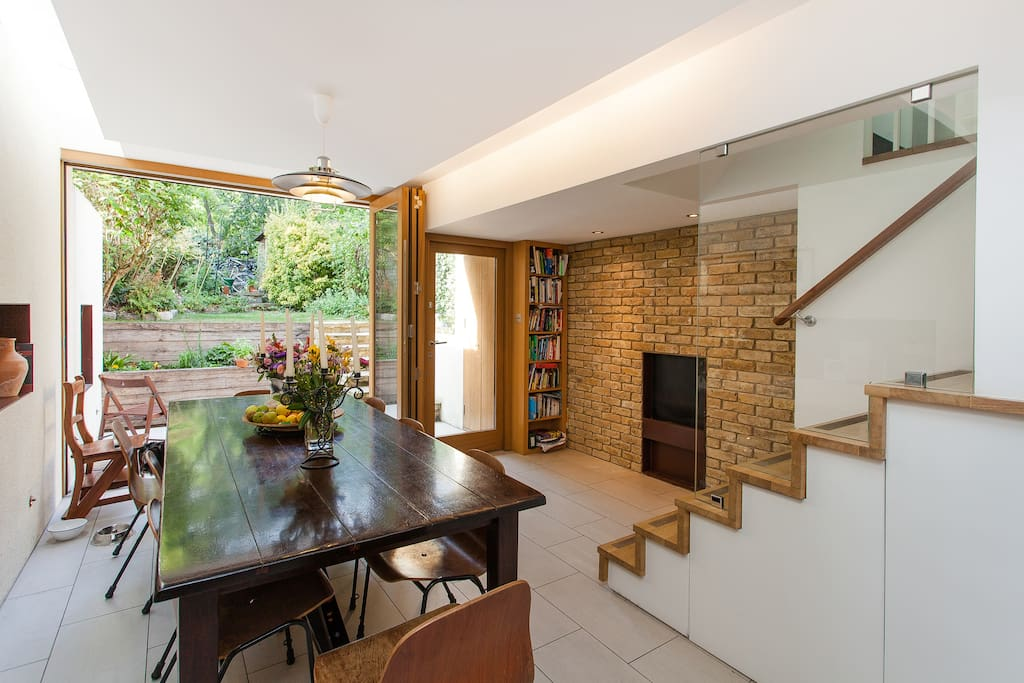 Fantastic entertaining space off kitchen,  working fireplace in brick wall, folding sliding doors to garden.