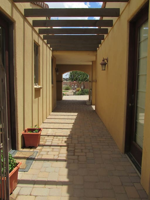 Breezeway between main home ang guesthouse.  Main entrance on the right.