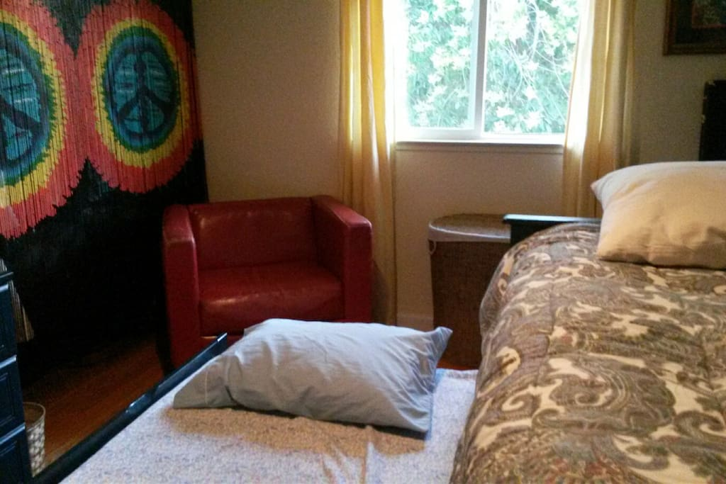 Peaceful room can accommodate two by pulling out the trundle drawer bed stored beneath.