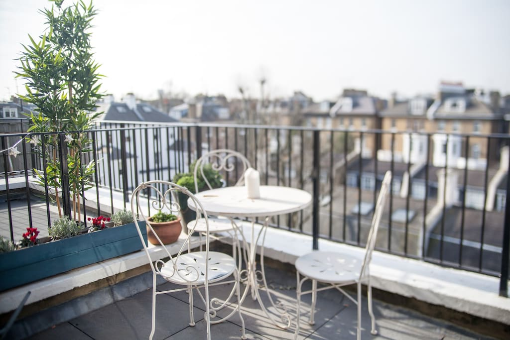 Balcony with view of private mews and herbs!