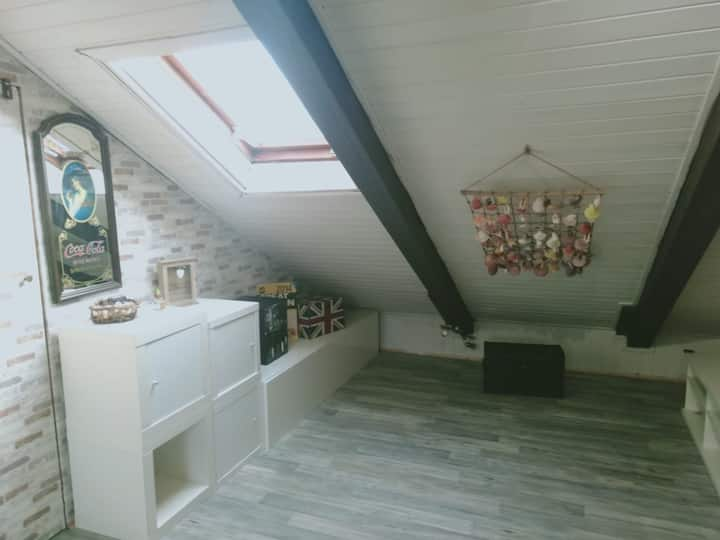 Stylish and bright attic in a terraced house
