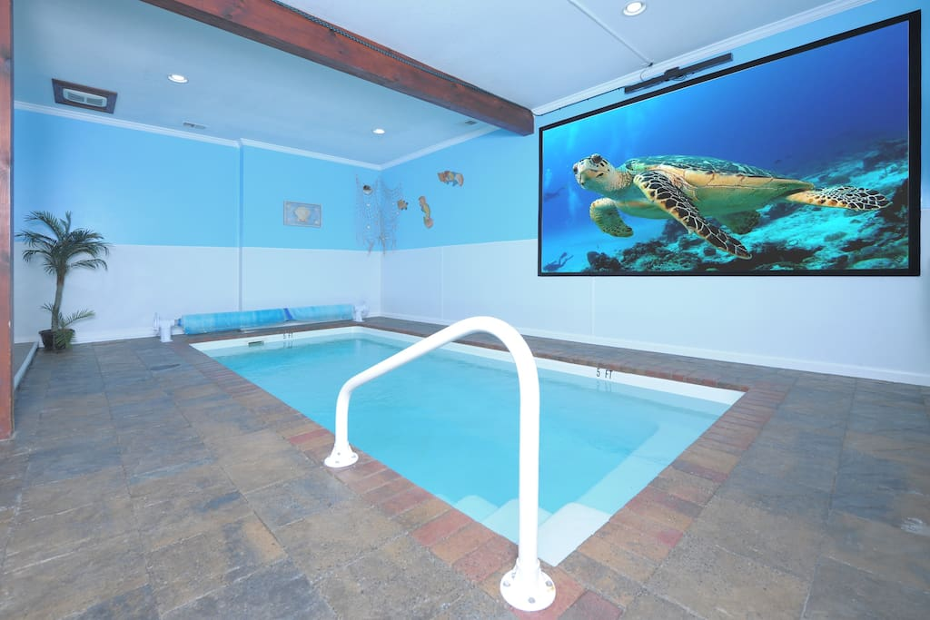 "Pool room with 125"" projector screen"
