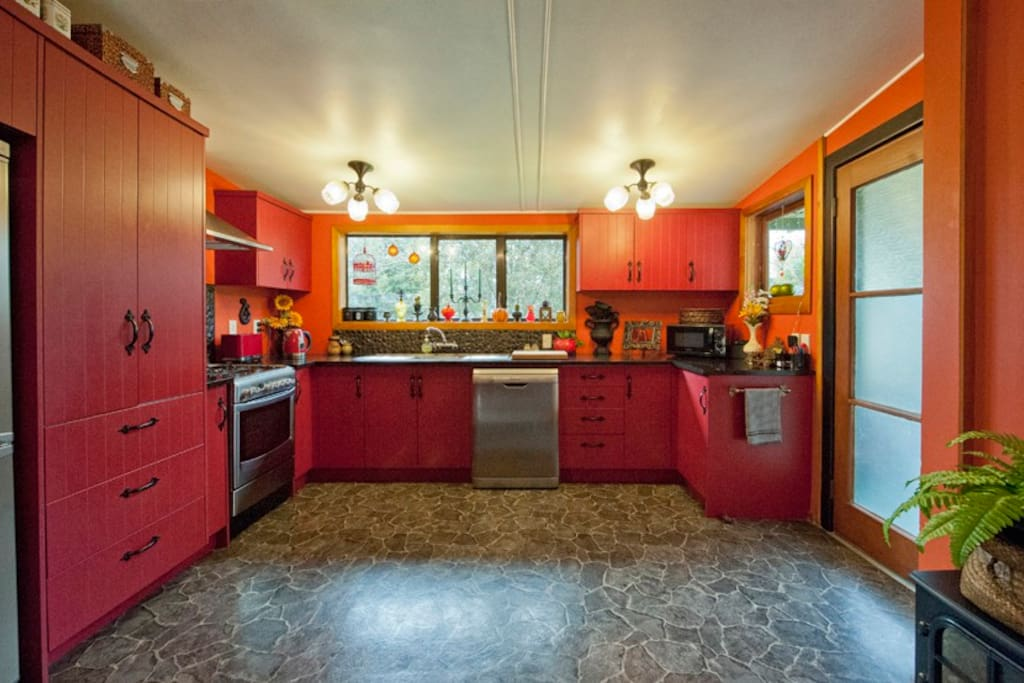 The kitchen is Art Deco and Retro. Stoned splash backs and slate Lino.