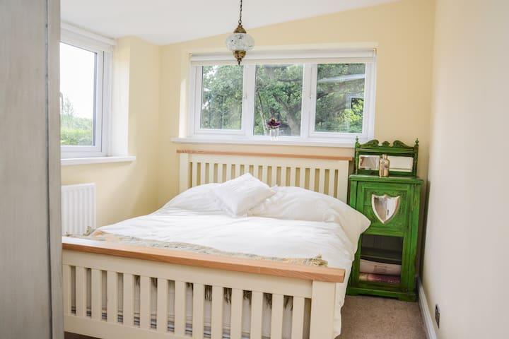 (1) Double bedroom with wardrobe.