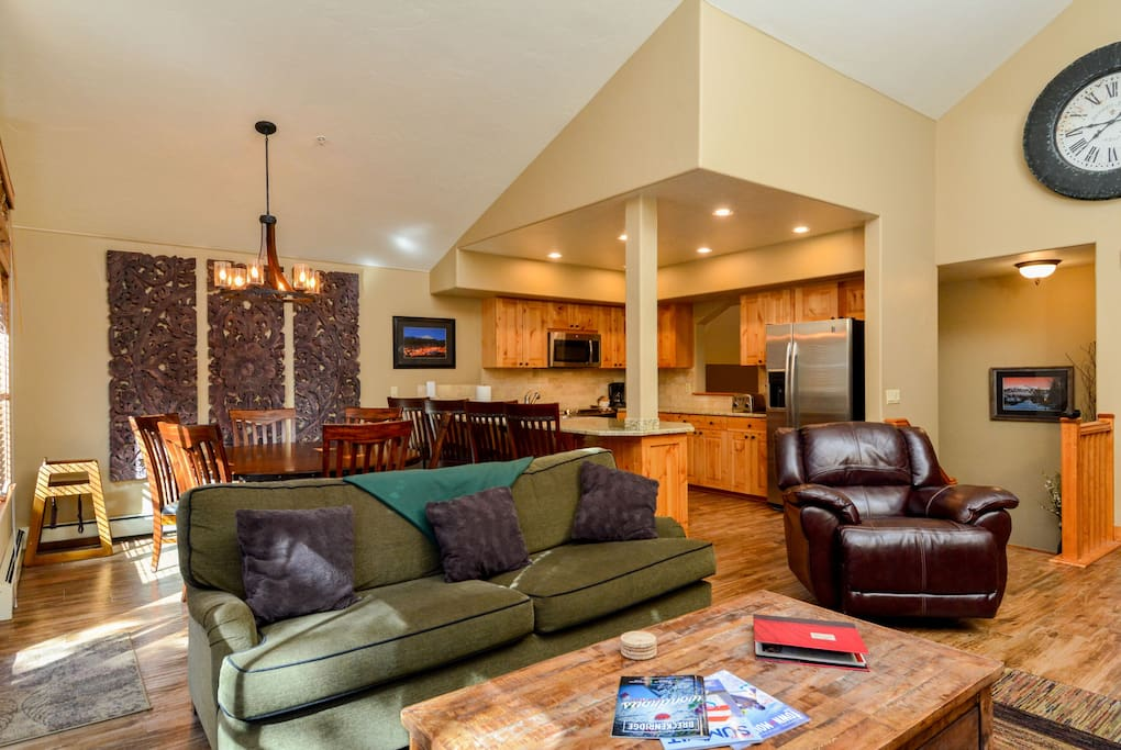 Large comfortable open living area with kitchen and dining room