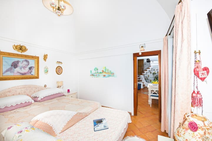 You will be able to enter the bedroom from the living room. The bedroom has a matrimonial bed (160 cm/62 inches, wider than a queen-size bed). In this room you will find a satellite television. From the bedroom you will be able to enter the balcony