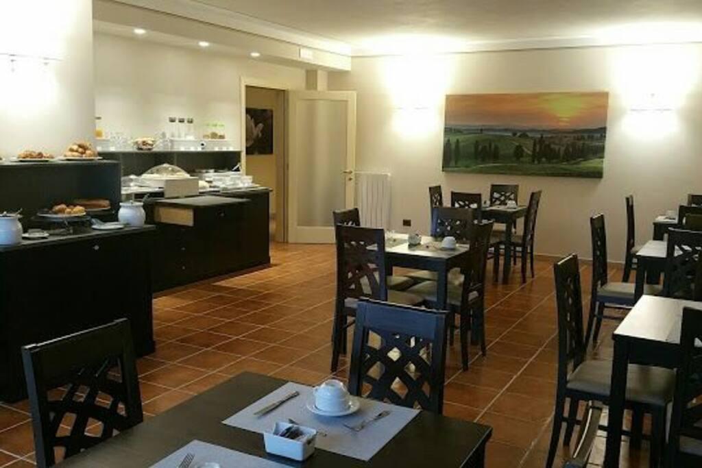 Sala colazioni o zona comune con cucina