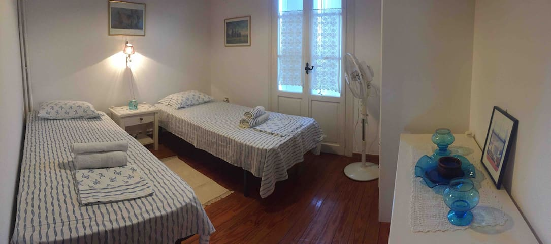 Twin Beds room with fan