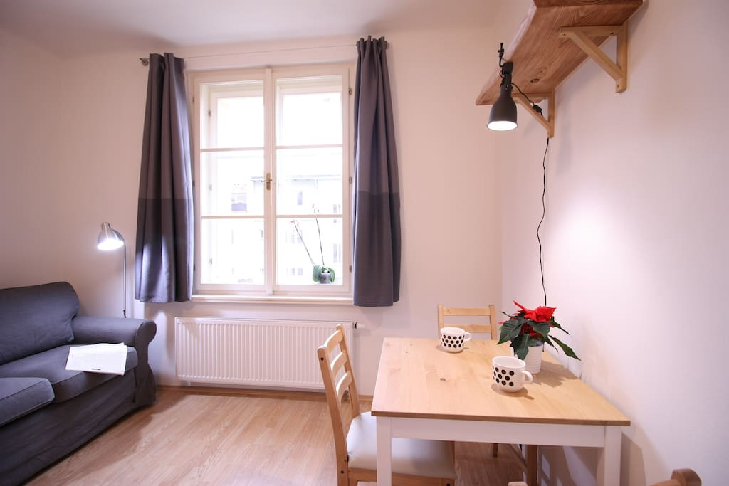 Kitchen with dining table and sofa for reading , having relax or sleeping..