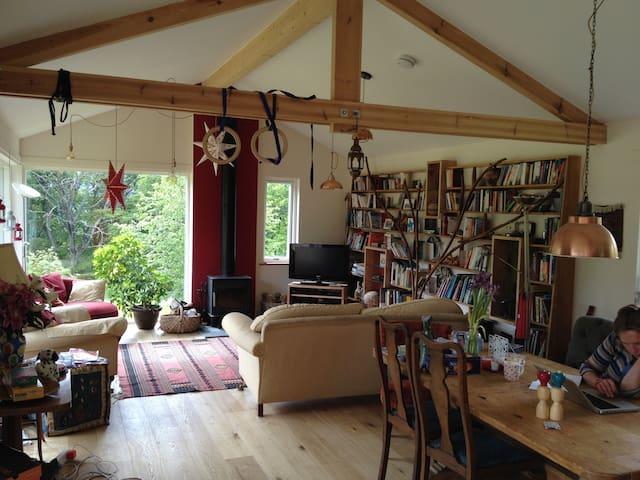 Living Room with views of the garden, TV, and wood burning stove.