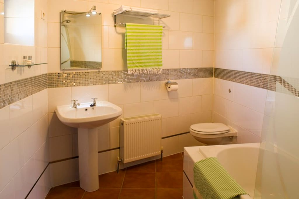 Beziers ensuite with bath and shower.