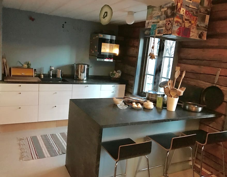 Kitchen island, elevated oven and street view.