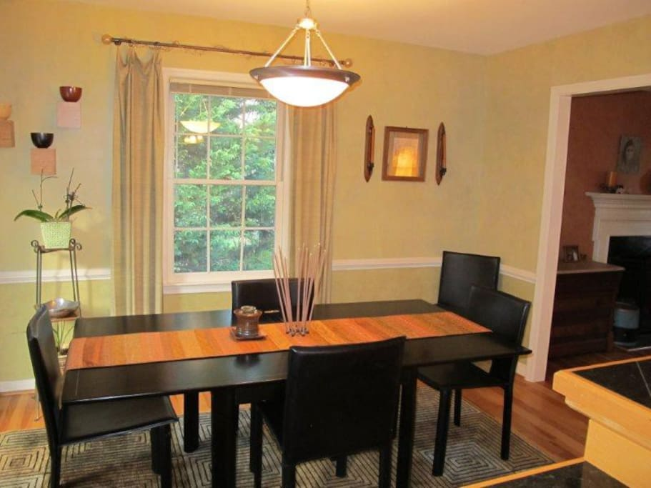 Dining room adjacent to kitchen and living room. Spacious table seats 6.