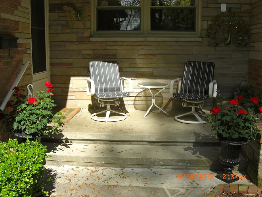 Covered front porch with slight view of Lake Michigan