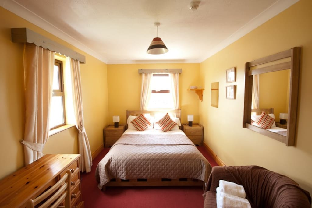 This is one of our rooms. It is bright, spacious and the 5' mattress is memory foam.