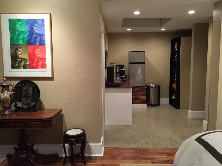 Main room looking into Kitchen.  Washer and Dryer, Microwave and Refrigerator and Freezer.