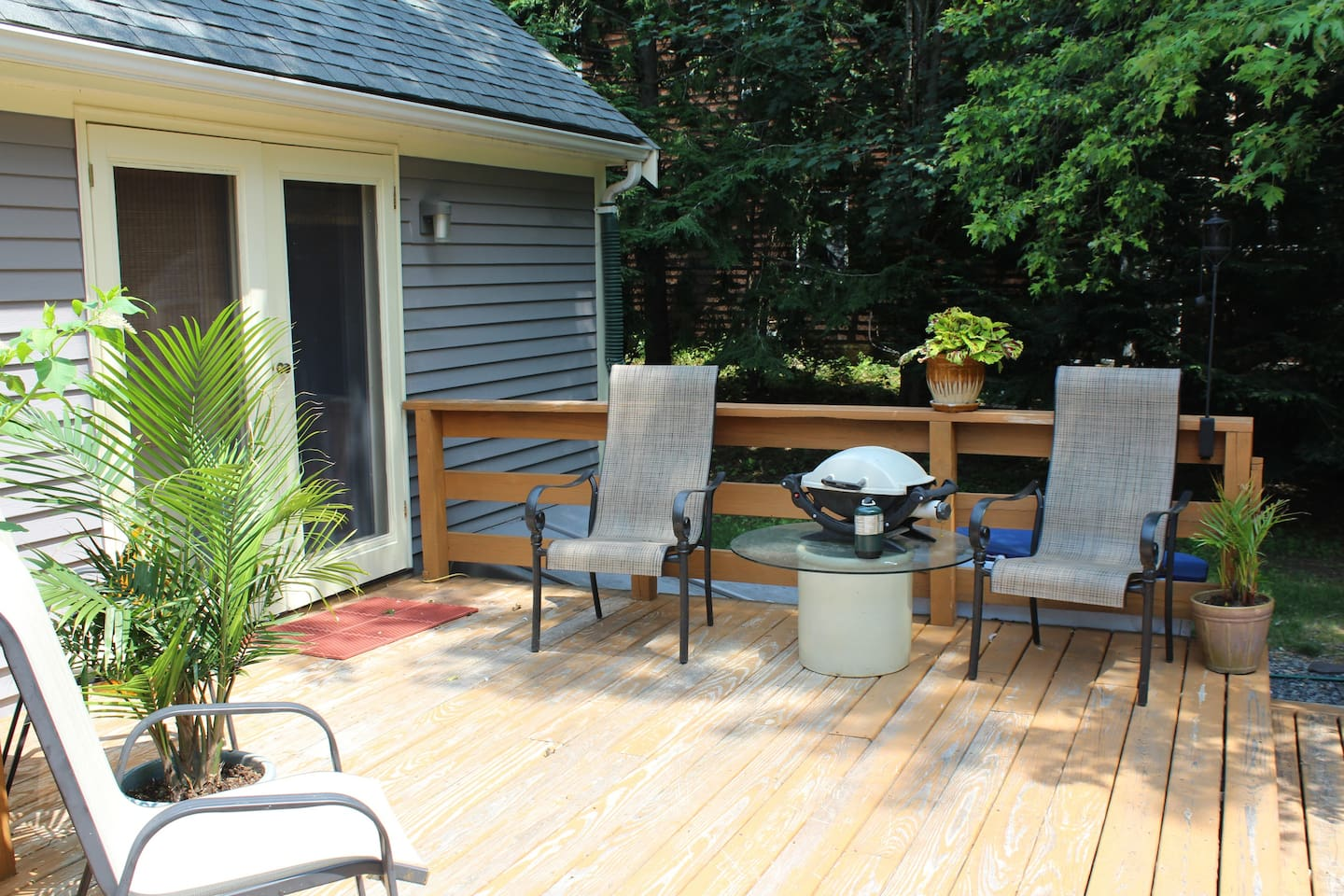 enjoy deck with sitting area and gas grill