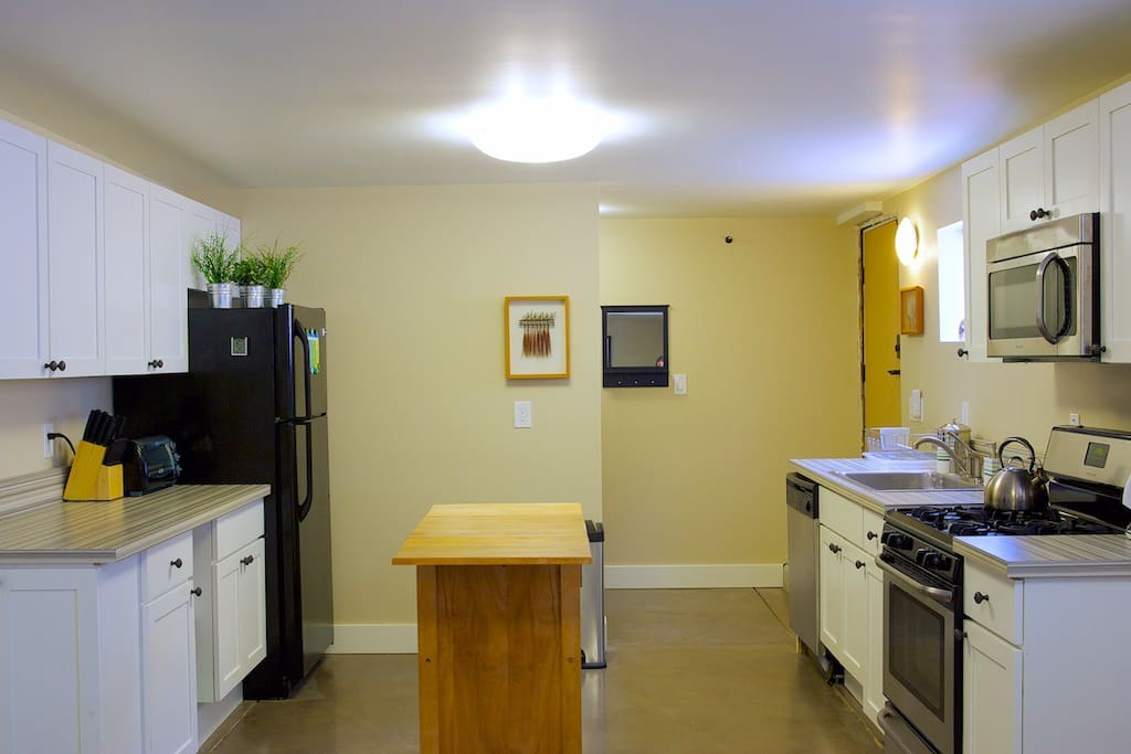 New full size modern kitchen with plenty of work space and all the amenities including 4 burner gas range and dishwasher!