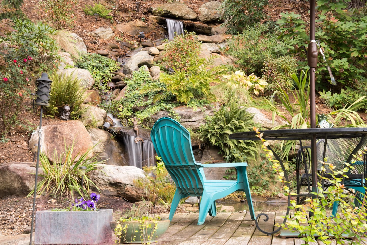 Beautiful water feature designed by the owners - what a peaceful, relaxing place to enjoy a picnic or read a book!