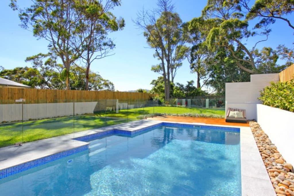 Large Pool and Glass fence with wrap around lawns